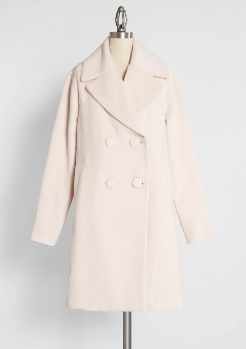 The coat in ivory