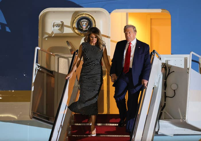 Donald and Melania Trump descend airplane stairs