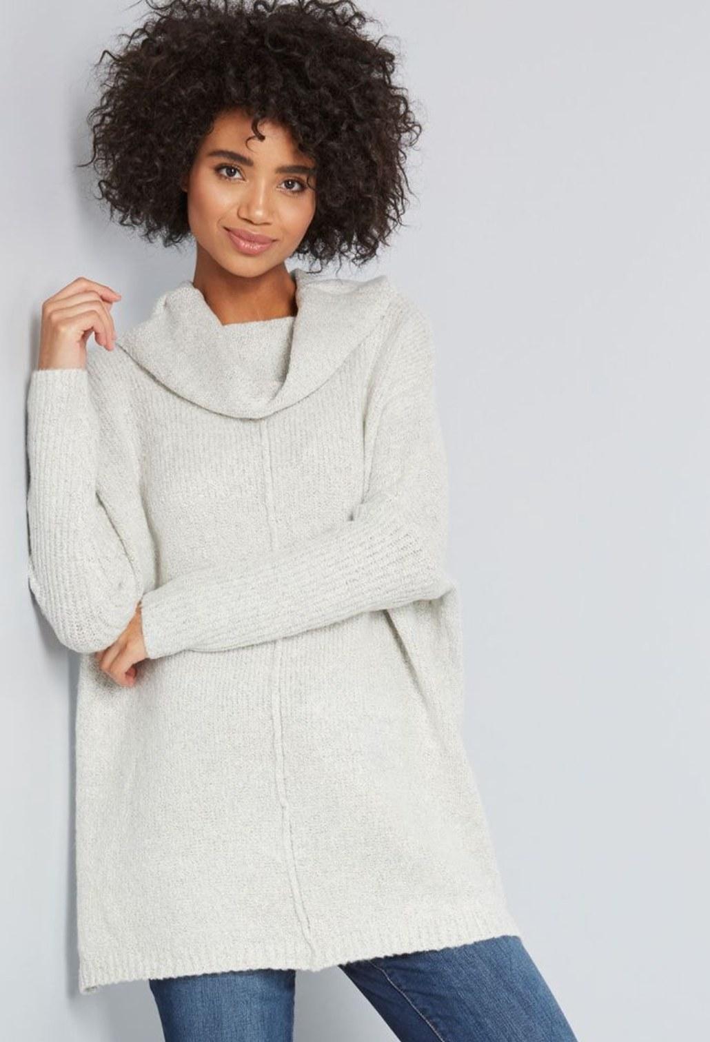 Model wearing the sweater in light grey