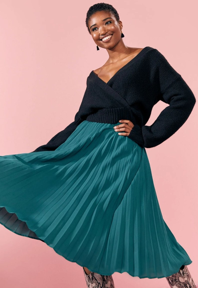 Model wearing the skirt in teal