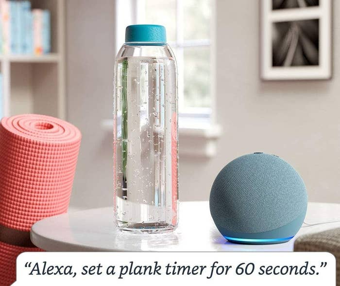 """An Echo Dot next to a water bottle and yoga mat with the text """"Alexa, set a plank timer for 60 seconds"""""""