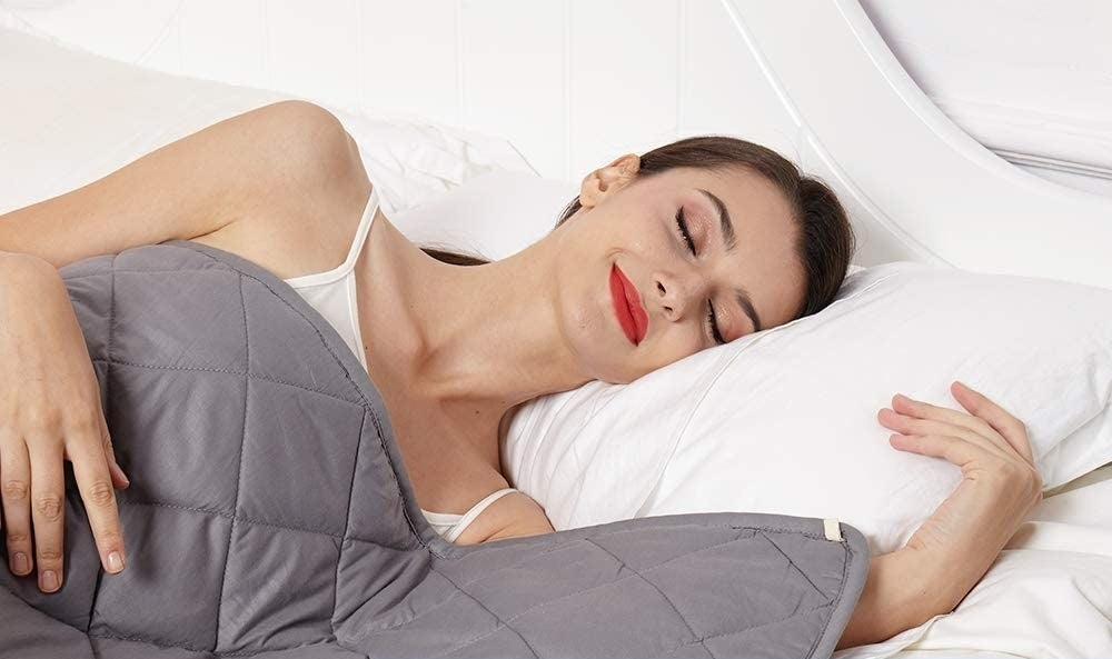A person sleeping with a quilted blanket on them