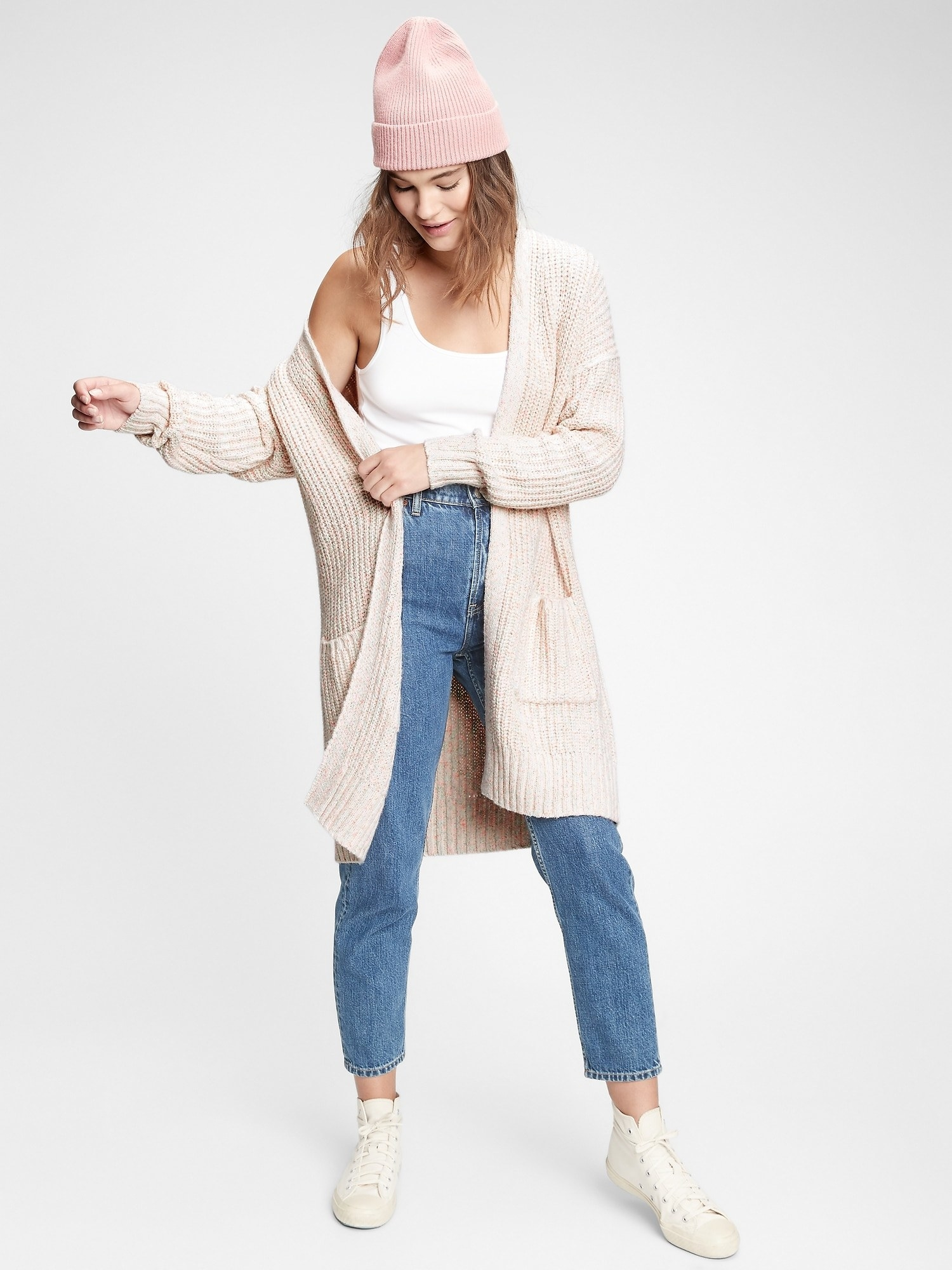 a model in an oatmeal colored long cardigan