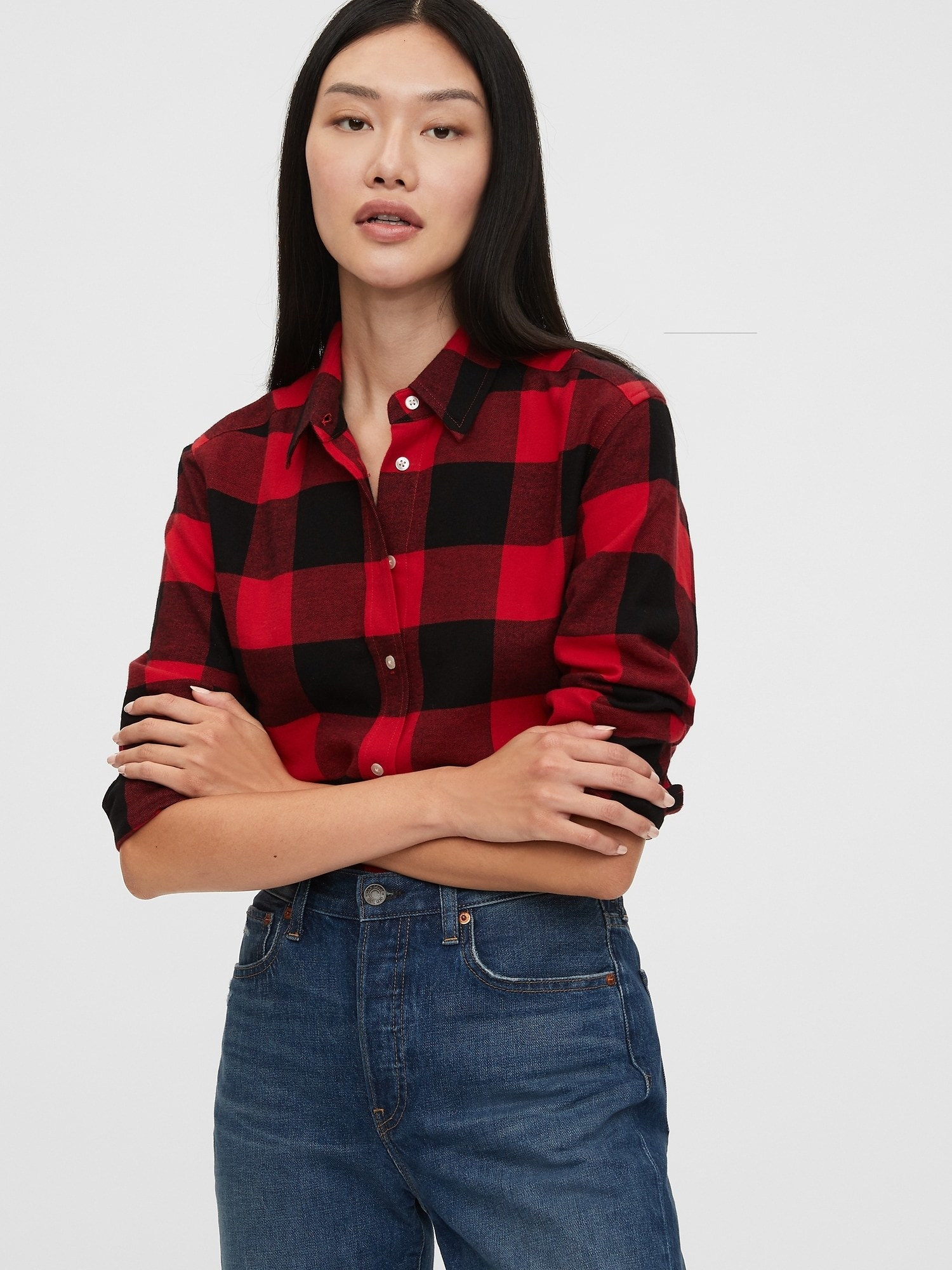 a model ina. red and black buffalo check flannel