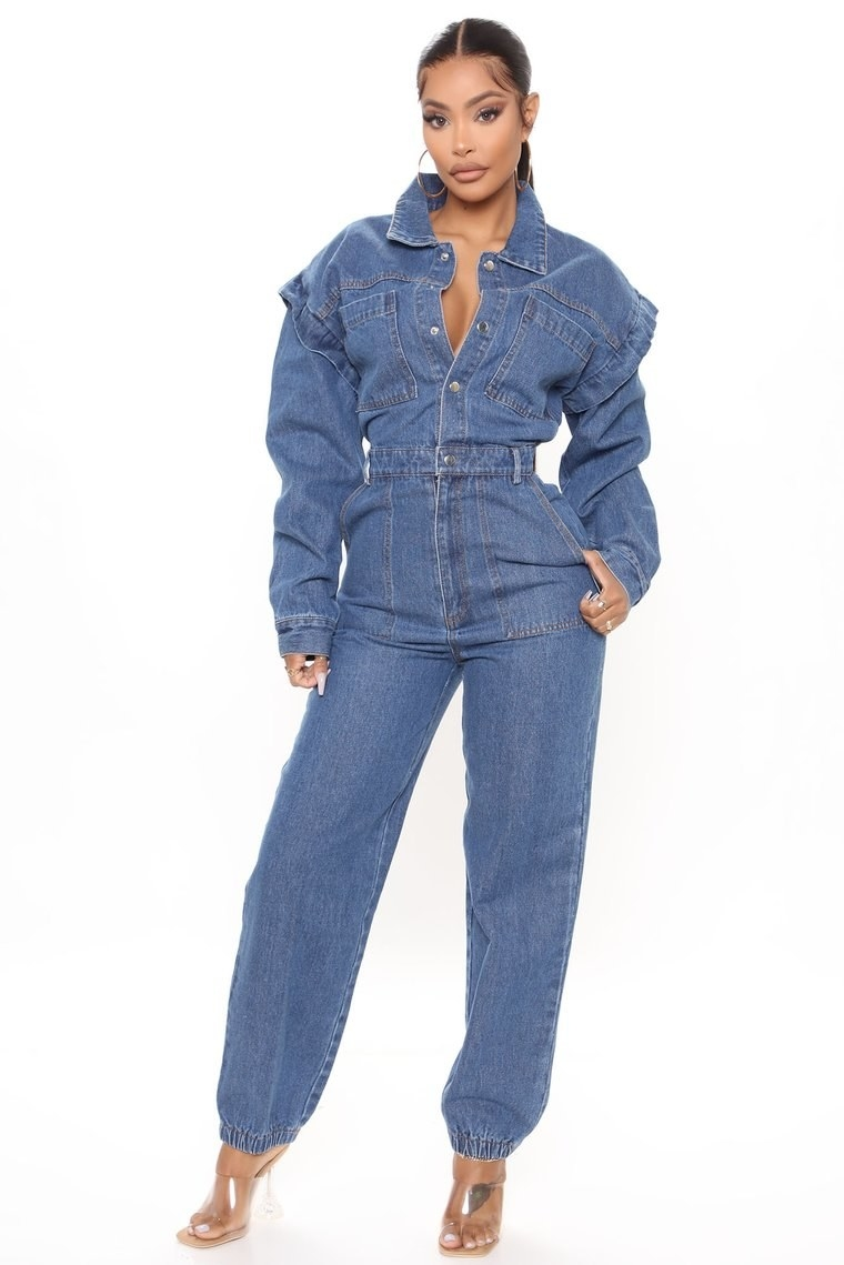 a model wearing the day to night denim jumpsuit