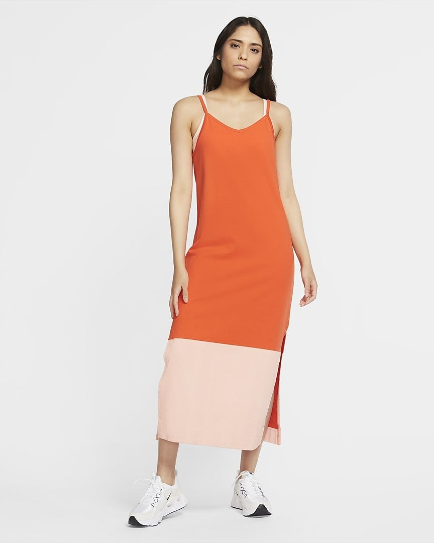 model wearing the orange dress