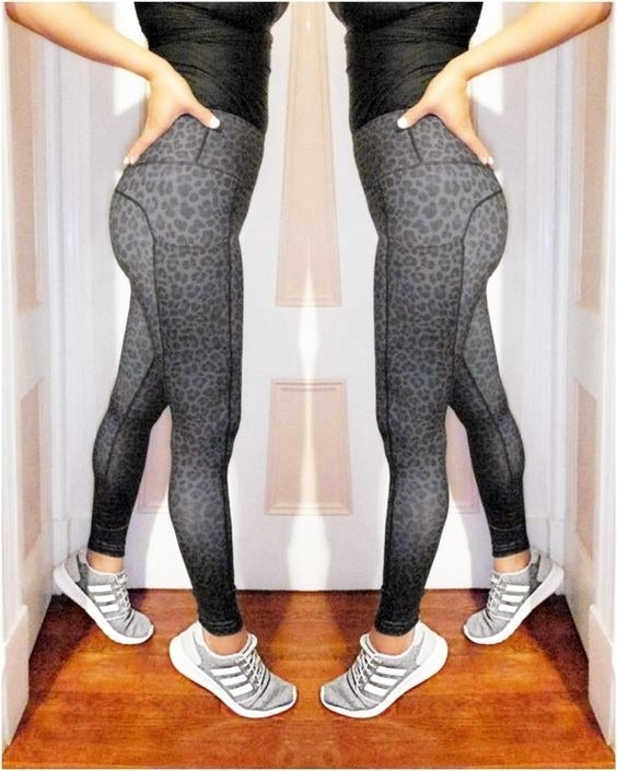 Reviewer wearing the gray leopard print leggings with deep side pockets