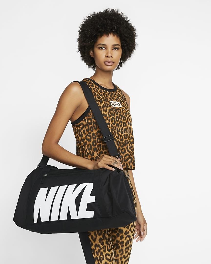 model wearing the black duffel bag