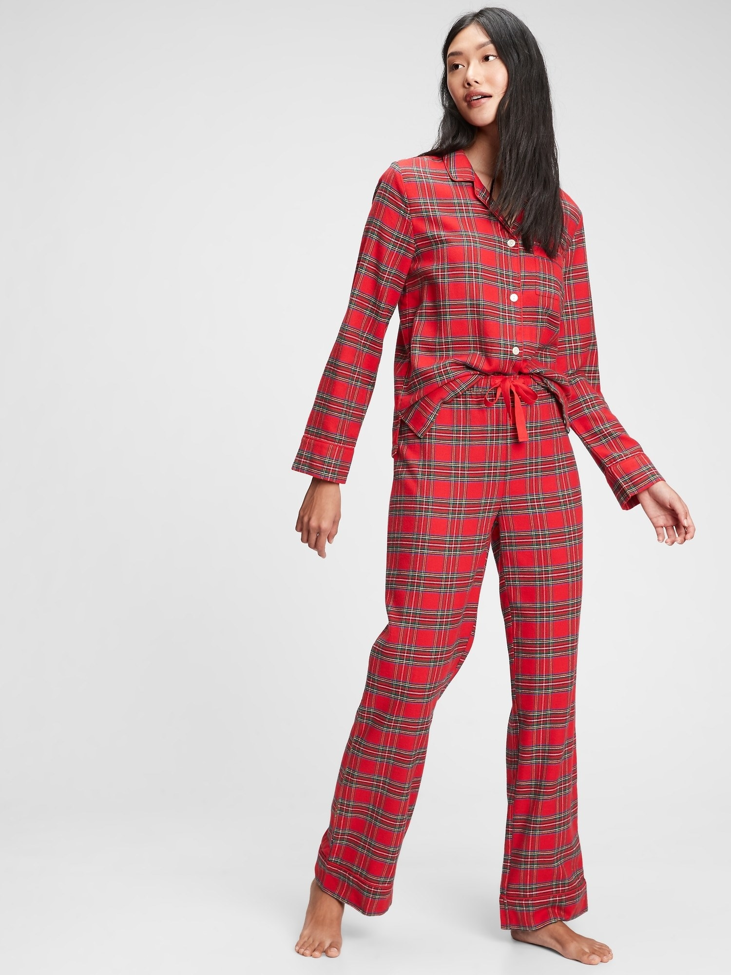 a model in red flannel pajamas