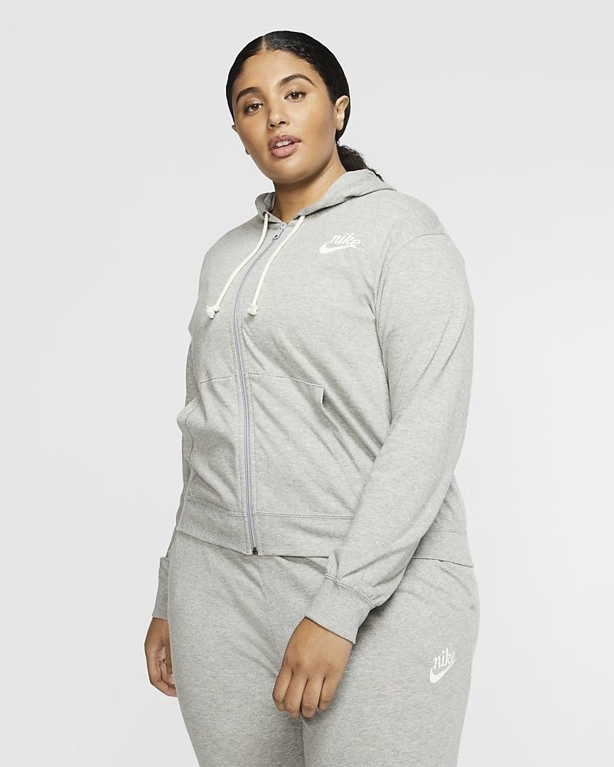 model wearing the gray drawstring hoodie