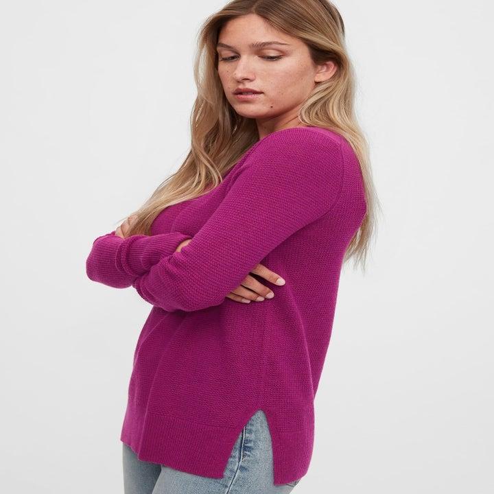 a model in the sweater in purple