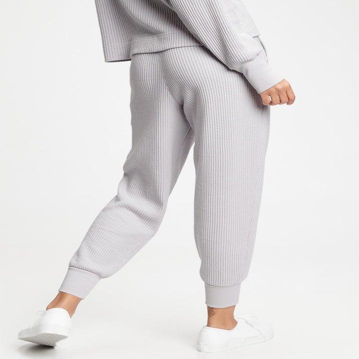 a model in light gray pants