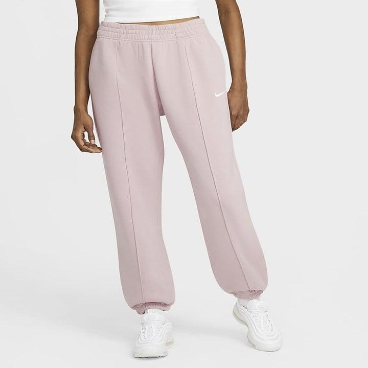 model wearing light pink sweatpants