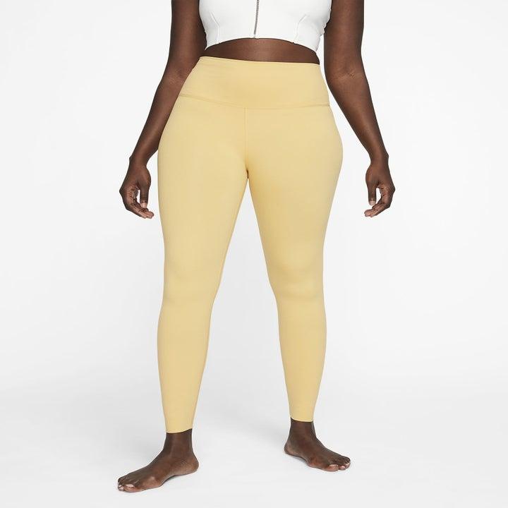 model wearing the yellow leggings