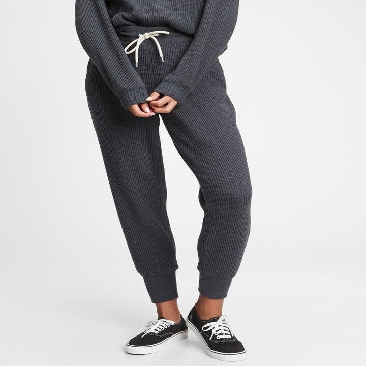 a model in dark gray pants