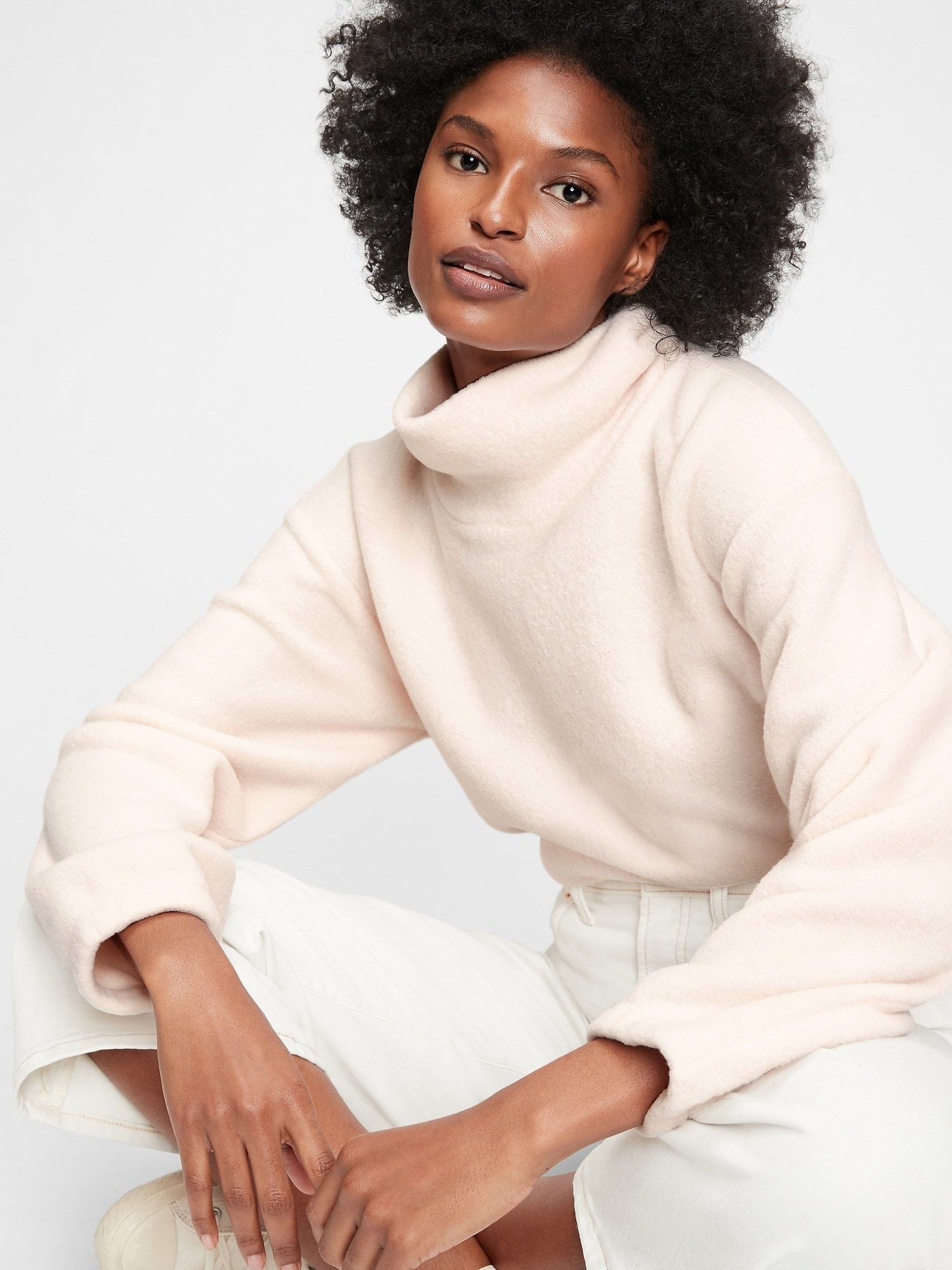 a model in the sweatshirt in cream