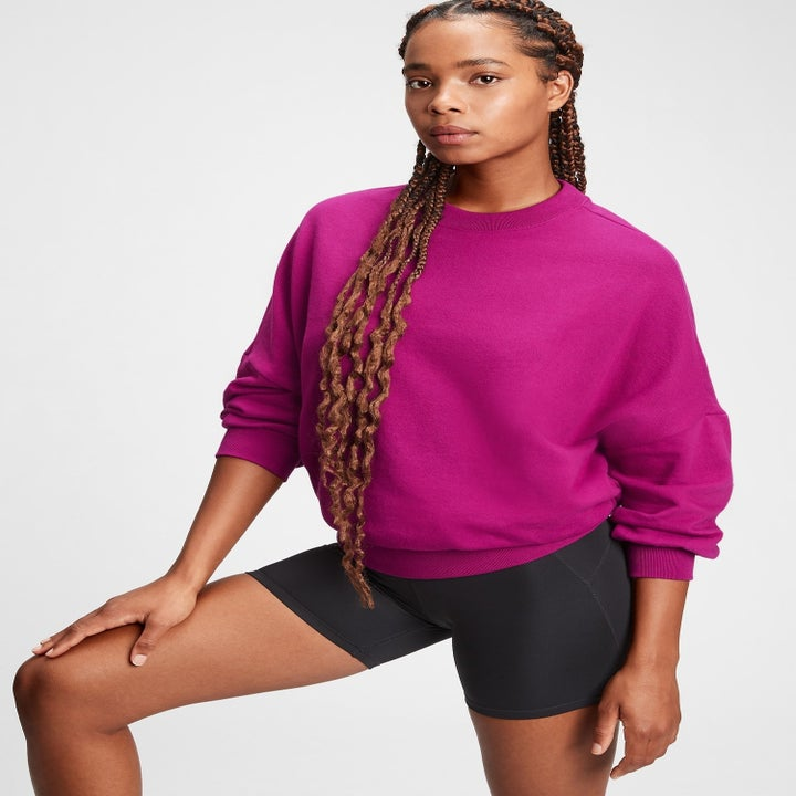 the same model in the sweatshirt in berry pink