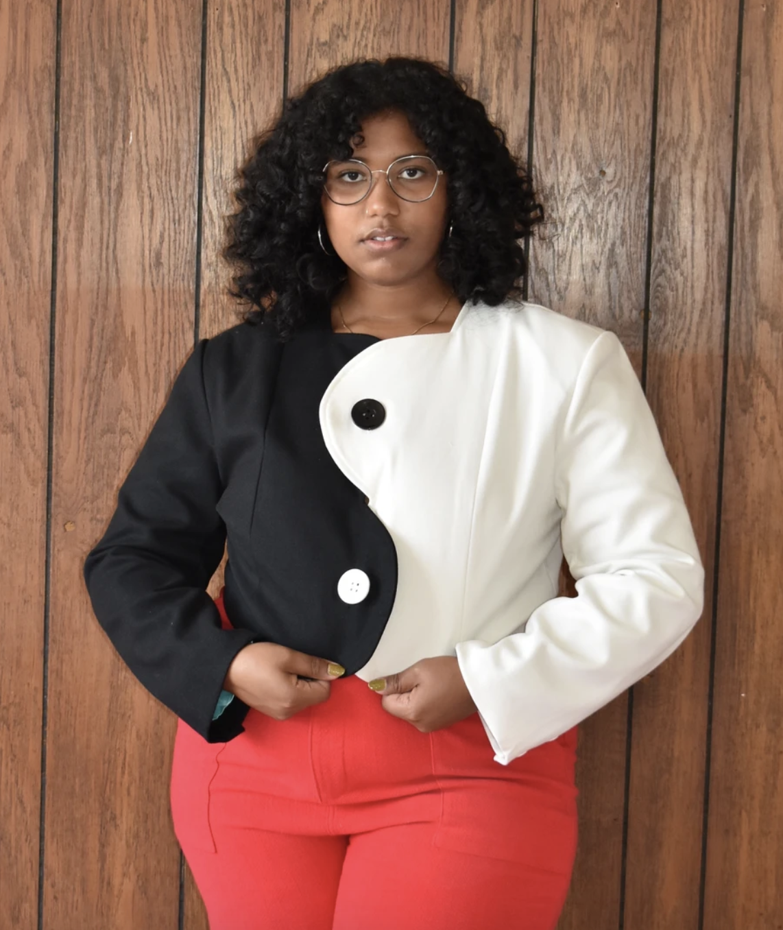 a plus size model wears the yin yang jacket