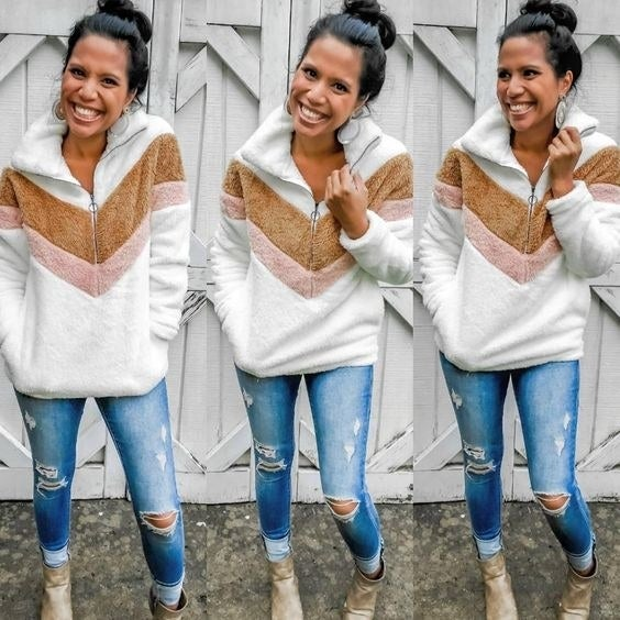 Reviewer wearing the fuzzy pullover in white, brown, and pink pattern