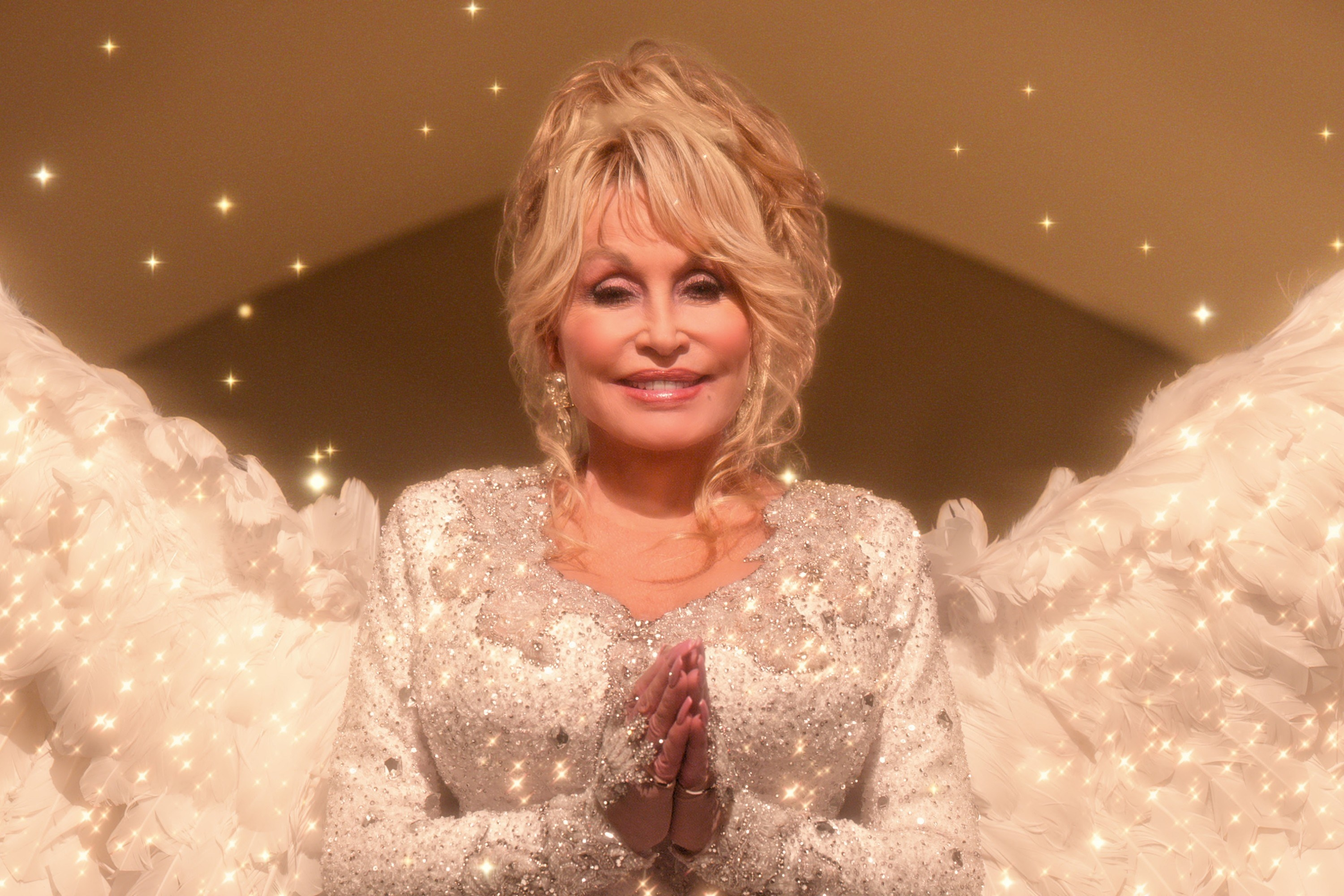 Dolly Parton dressed as an angel for Christmas on the Square