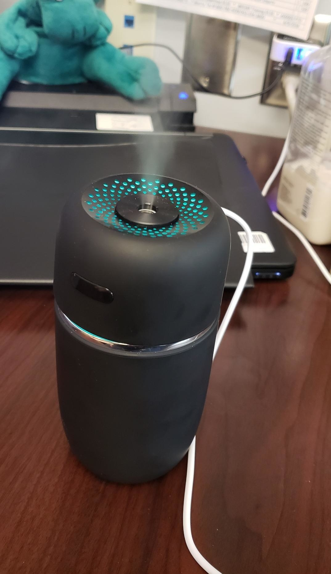 Reviewer using humidifier night light on desk