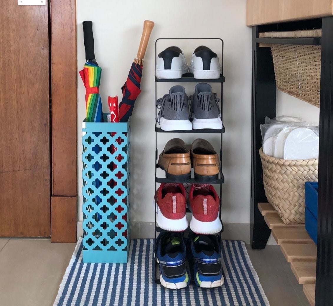 reviewer photo showing shoe rack in their entryway