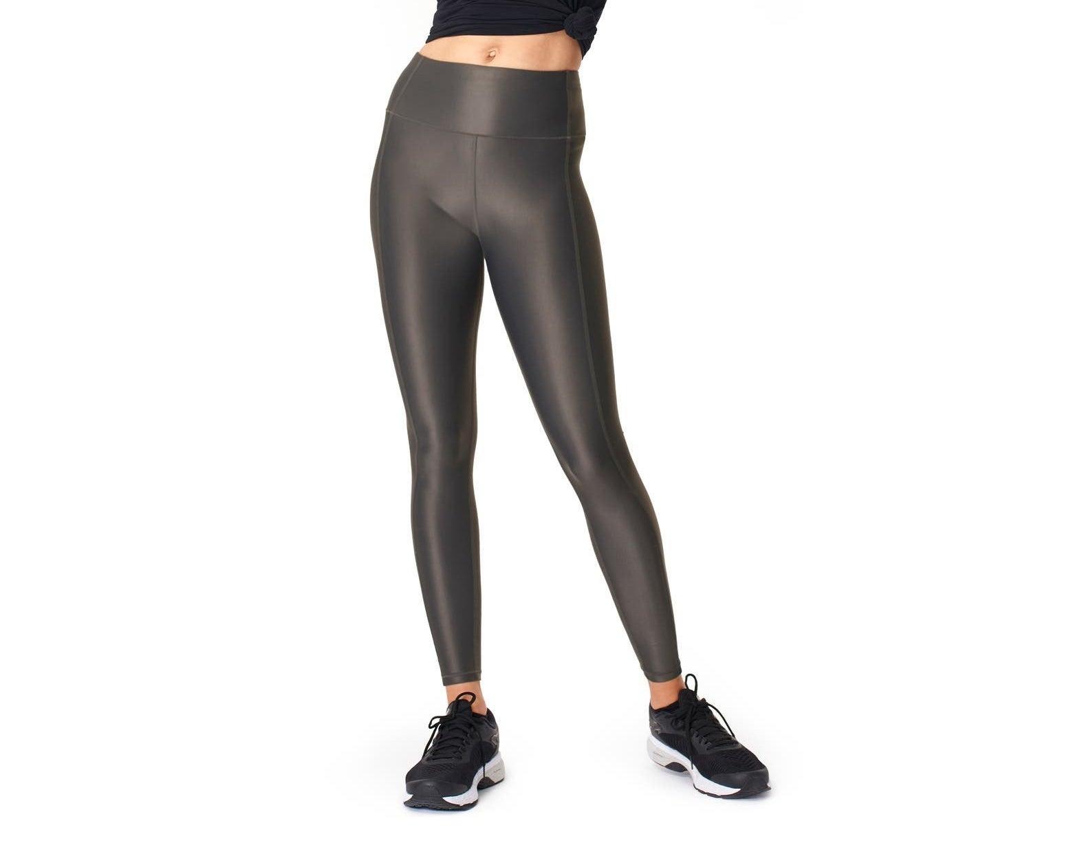 Model wearing the shiny black leggings