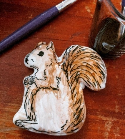 A community member's cookie with a painting of a squirrel on it