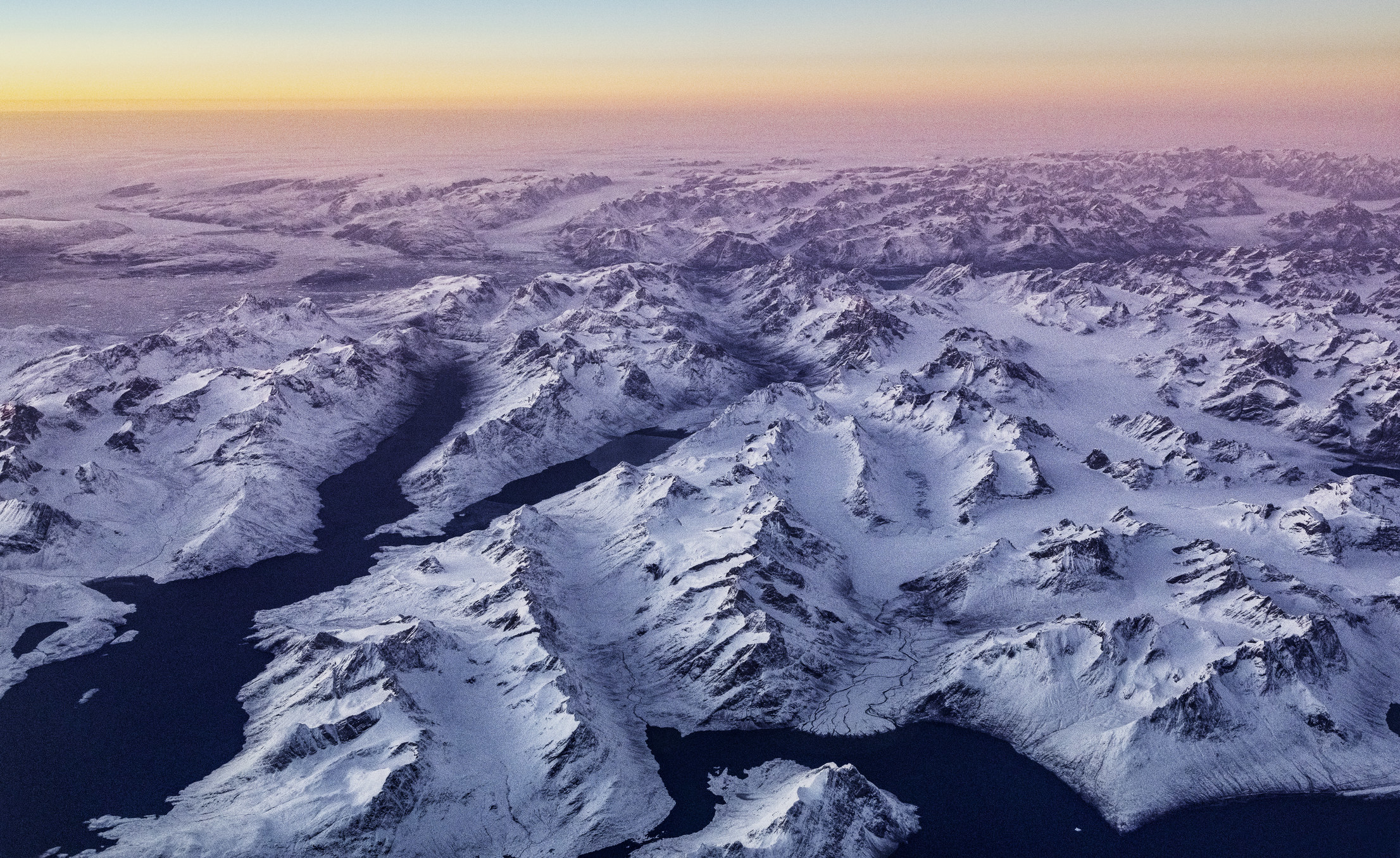 An aerial shot of mountains in Greenland