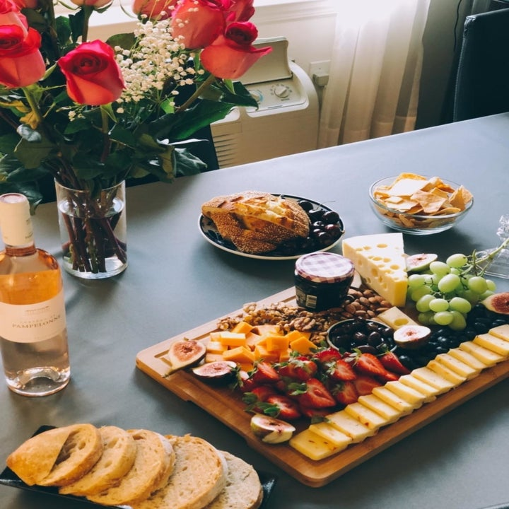 Reviewer using product as charcuterie board