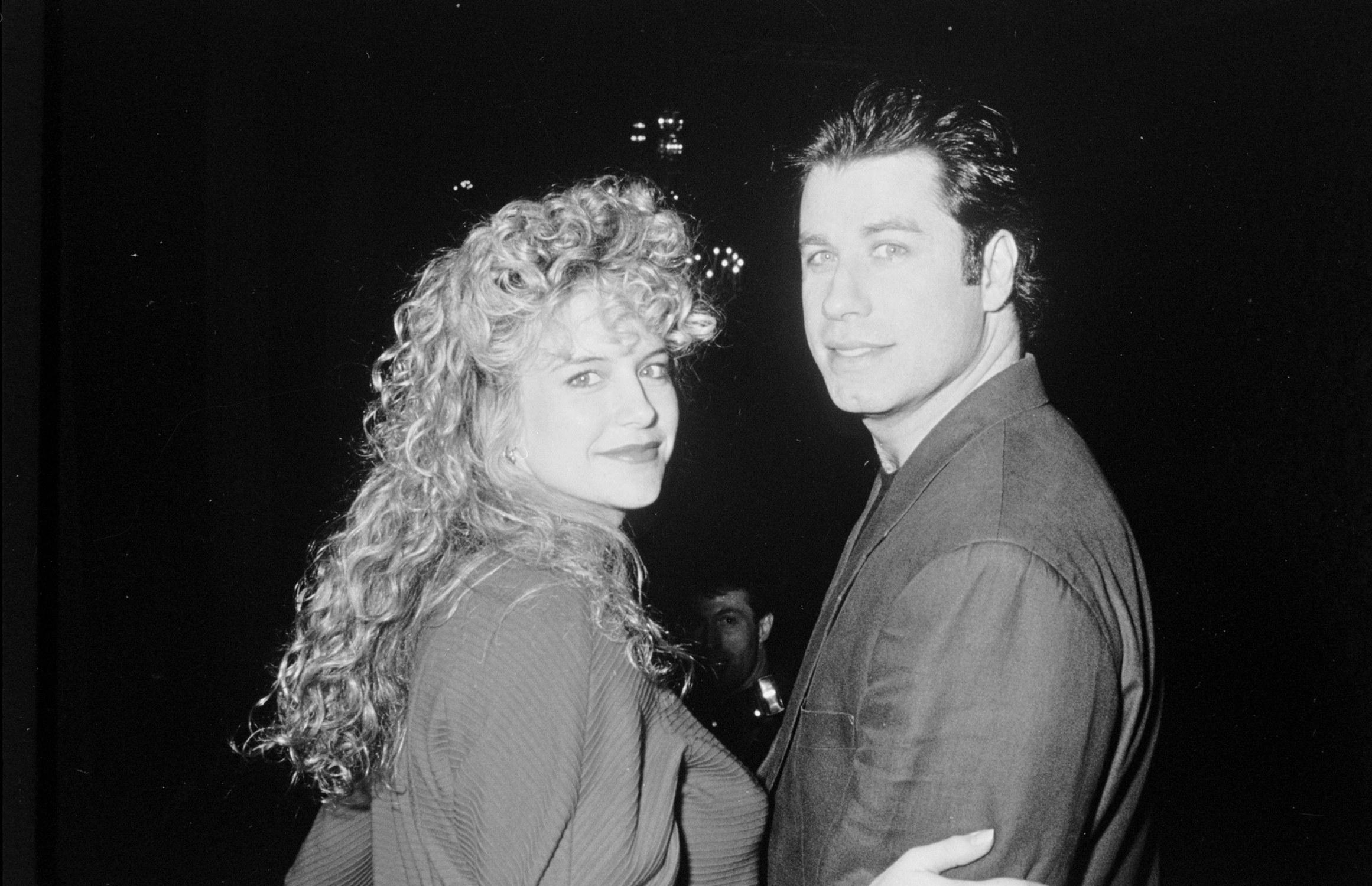 Preston holding on to the arm of John Travolta