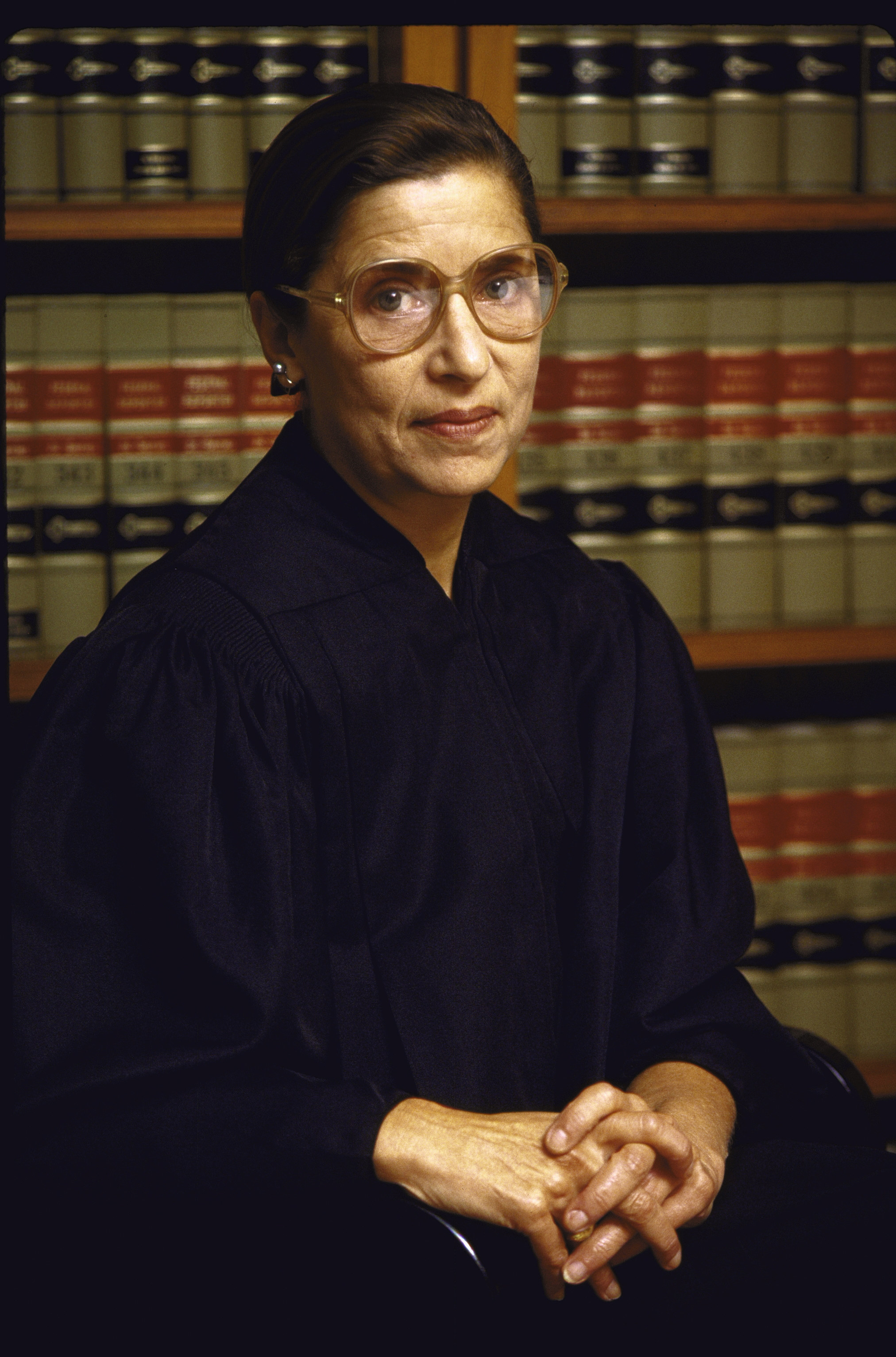 Ginsburg in robes and in front of a bookcase