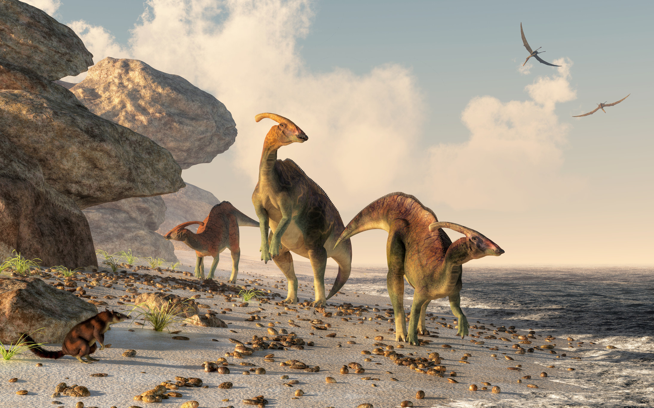 A 3D rendering of dinosaurs on a beach