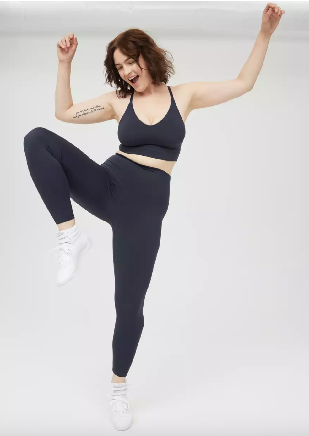 a model in navy blue leggings