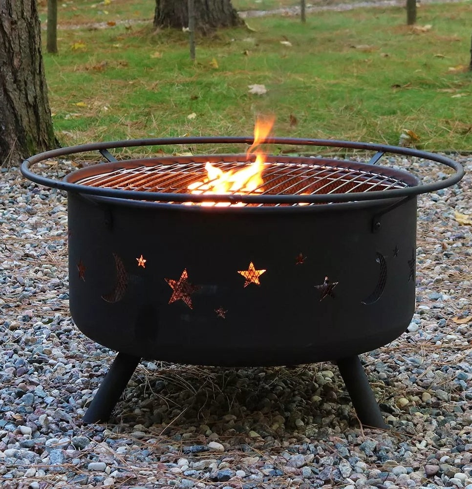 The fire pit with star and moon cutouts
