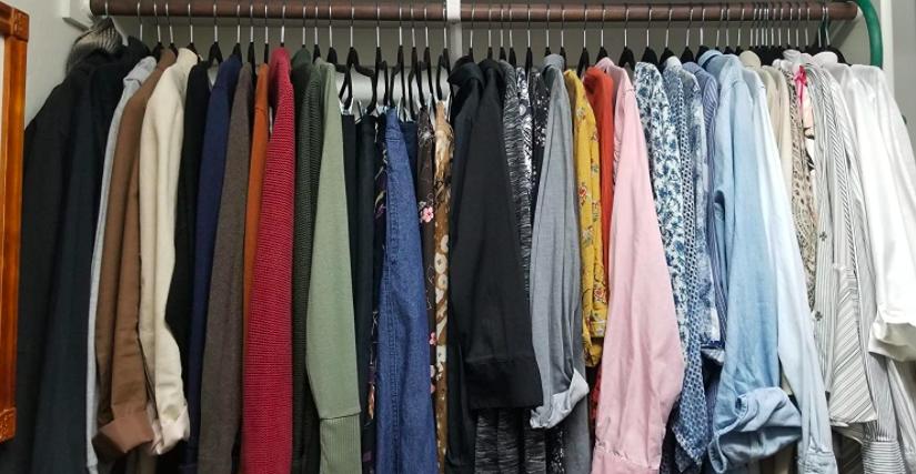 Space-saving velvet clothing hangers in closet