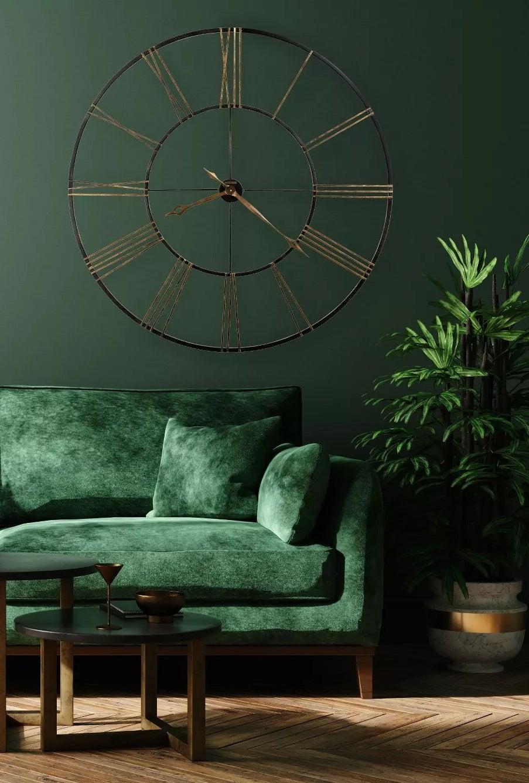 The wrought-iron clock