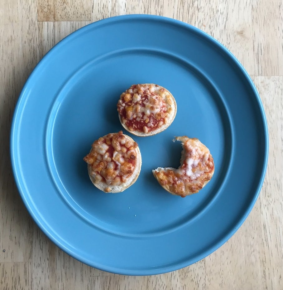 Three Bagel Bites on a blue plate