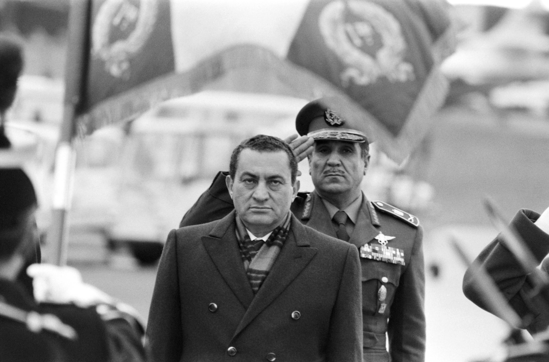 Mubarak looking grim as people salute him