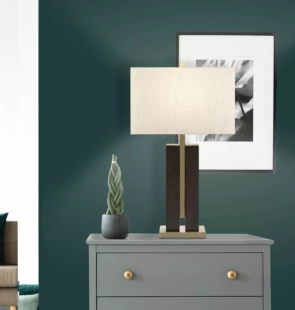 The black, copper, and white table lamp