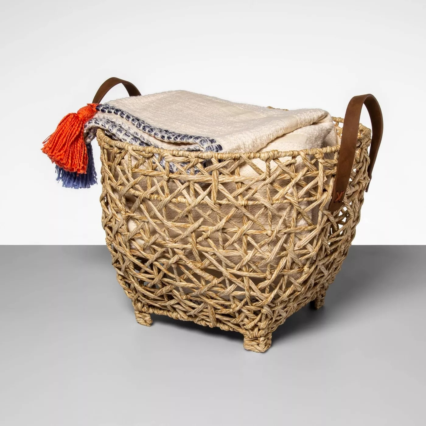 The basket with feet and leather handles