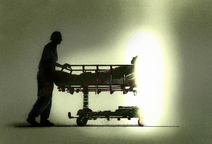 An illustration of a doctor pushing a stretcher into a bright light
