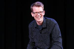Hank smiles on stage at an event