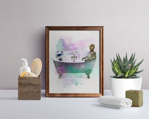 Star Wars-inspired art print of R2-D2 and C-3PO in a colorful bathtub on top of bathroom vanity