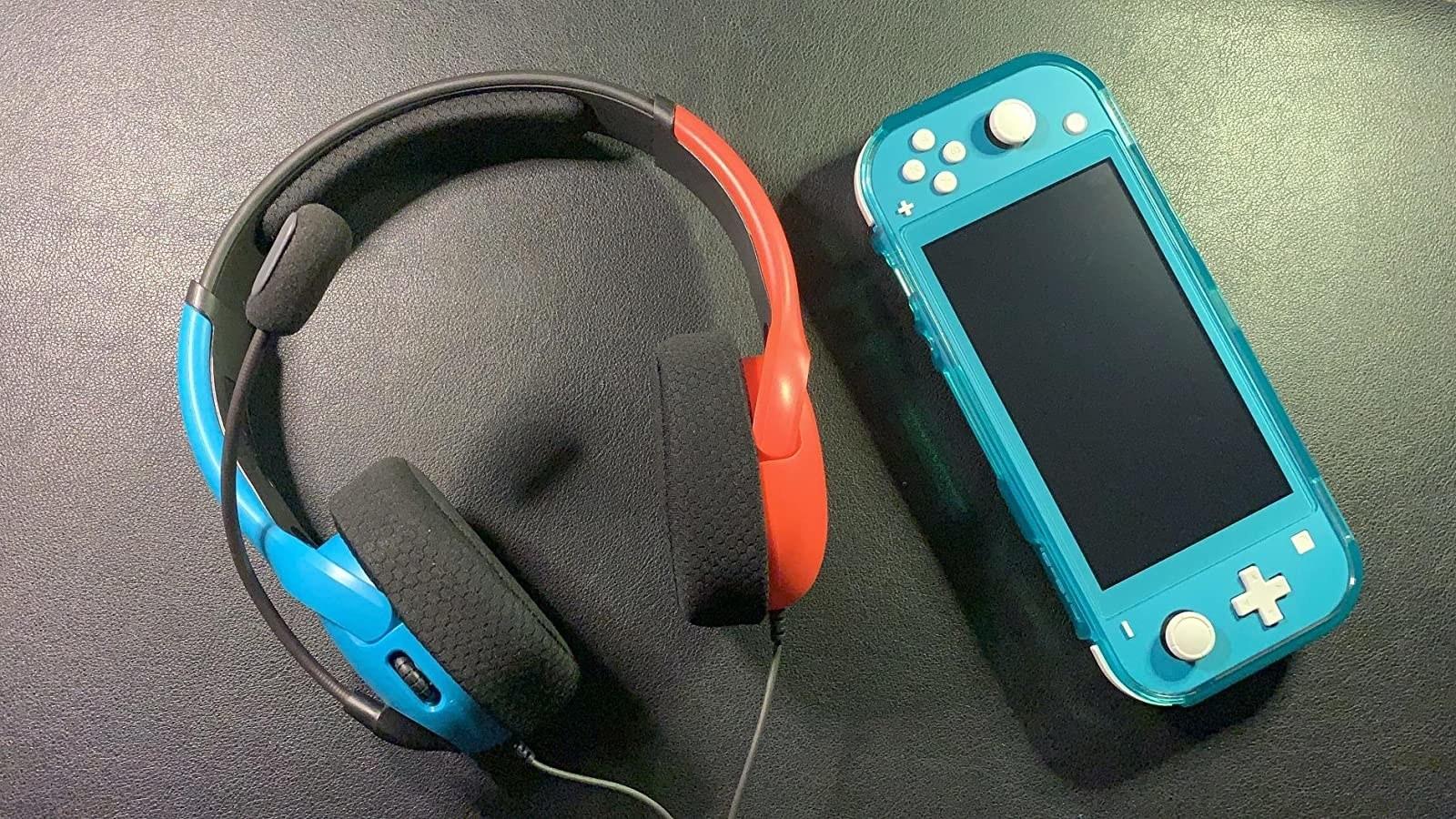 Nintendo Switch headset next to Nintendo Switch Lite.