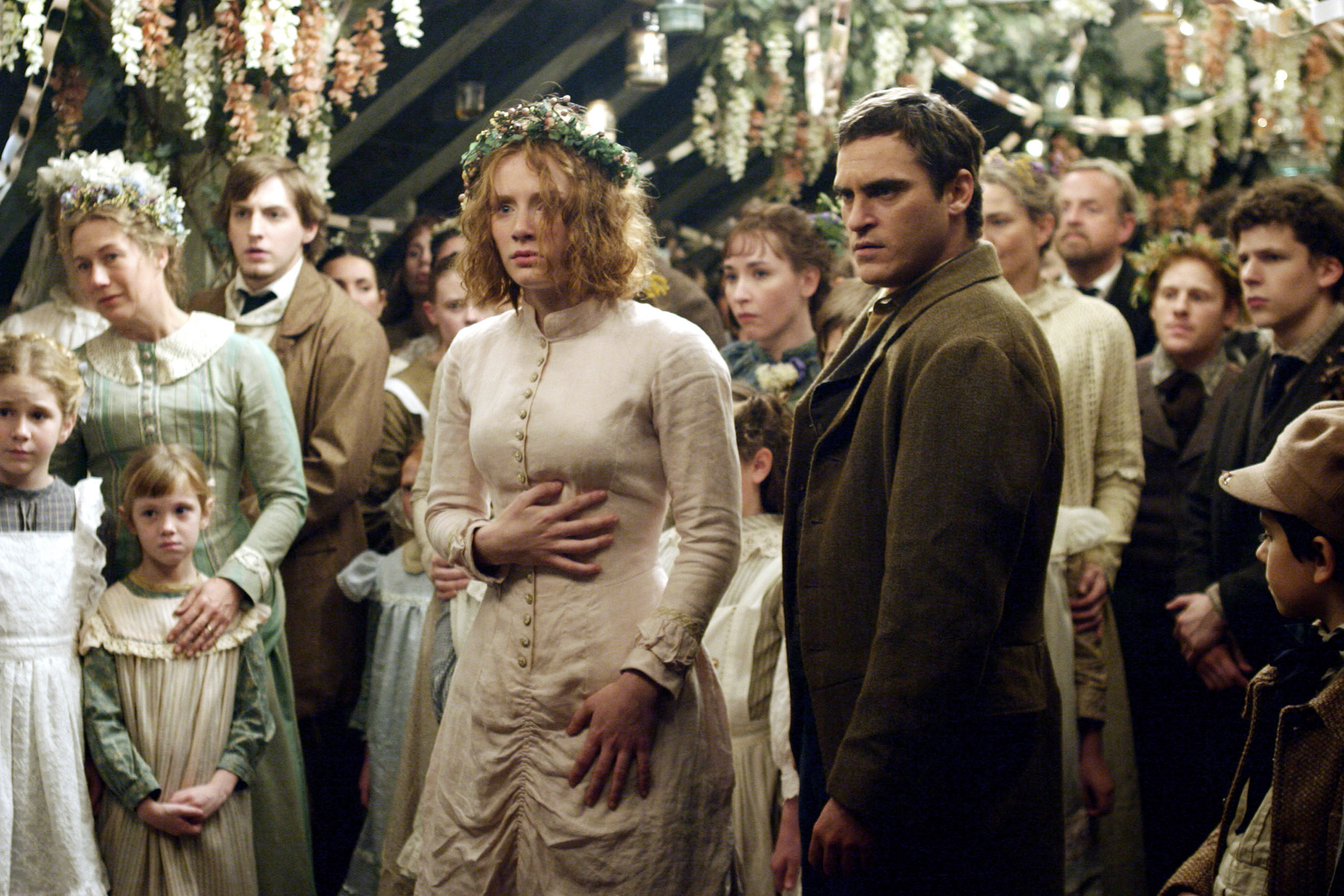 Ivy Walking and Lucius Hunt gather in a crowd looking concered
