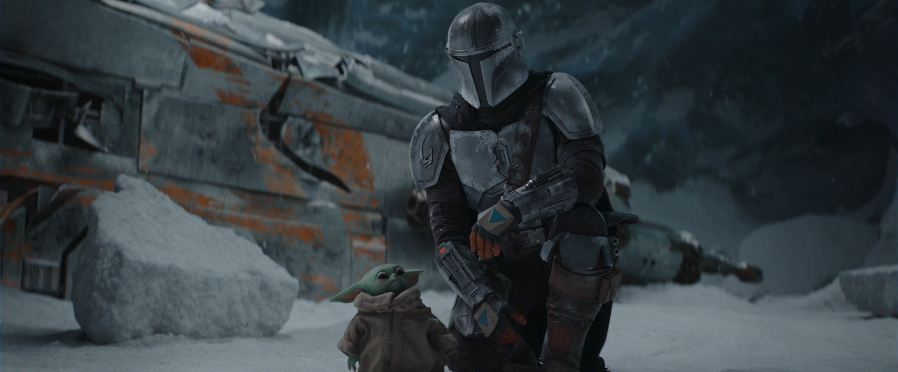 THE MANDALORIAN, from left: The Child (aka Baby Yoda), Pedro Pascal (as The Mandalorian)