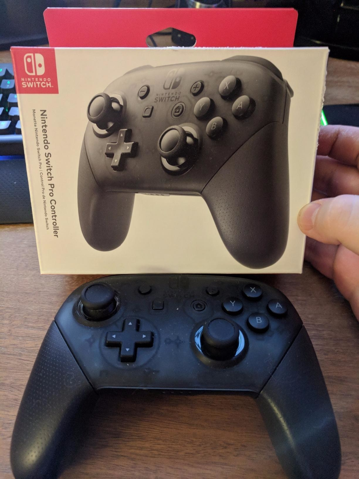 Amazon reviewer photo of black Nintendo Switch Pro Controller and packaging