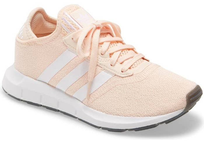 Swift Run X Sneaker in peach with white side stripes and a white sole