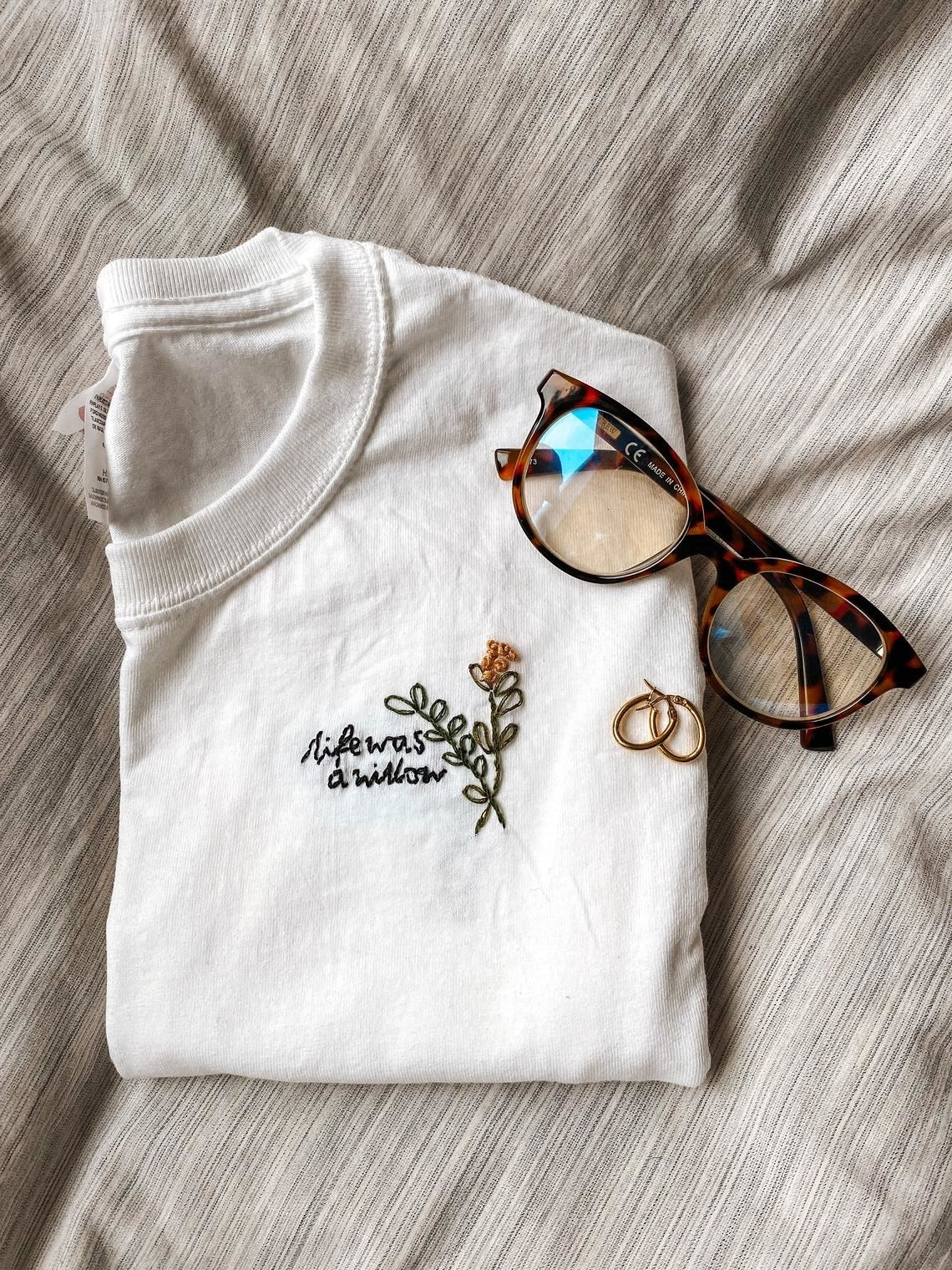 white crewneck that says life was a willow